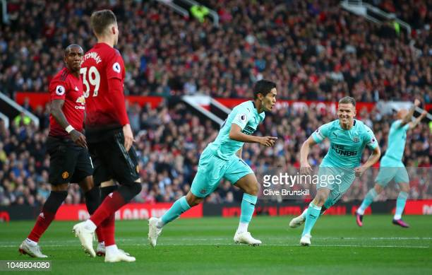 Yoshinori Muto of Newcastle United celebrates after scoring his team's second goal during the Premier League match between Manchester United and...