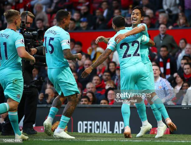 Yoshinori Muto of Newcastle United celebrates with teammate Deandre Yedlin after scoring his team's second goal during the Premier League match...