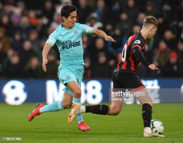 Yoshinori Muto of Newcastle United closes down David Brooks of AFC Bournemouth during the Premier League match between AFC Bournemouth and Newcastle...
