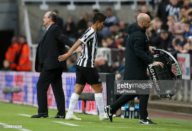 Yoshinori Muto of Newcastle United comes off and shakes hands with Rafael Benitez Manager of Newcastle United during the Premier League match between...