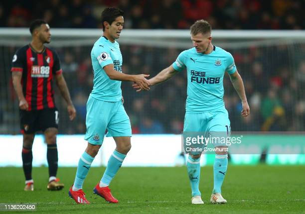 Yoshinori Muto of Newcastle United congratulates Matt Ritchie of Newcastle United after he scores his teams second goal during the Premier League...