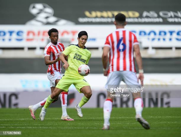 Yoshinori Muto of Newcastle United FC controls the ball during the Pre Season Friendly between Newcastle United and Stoke City at St James' Park on...