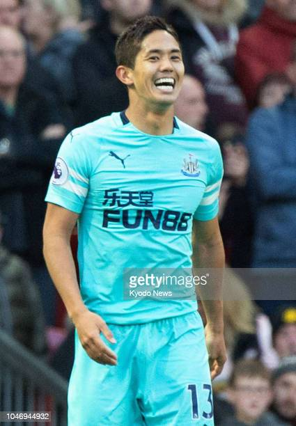 Yoshinori Muto of Newcastle United reacts after scoring his team's second goal during the first half of a Premier League match against Manchester...