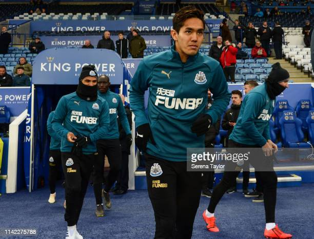 Yoshinori Muto of Newcastle United runs outside to warm up during the Premier League match between Leicester City and Newcastle United at The King...