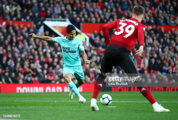 Yoshinori Muto of Newcastle United scores his team's second goal during the Premier League match between Manchester United and Newcastle United at...