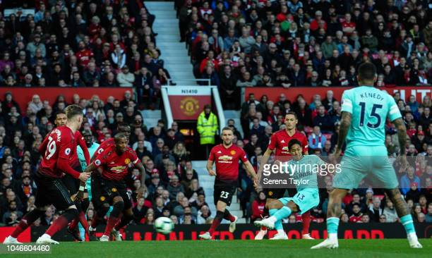 Yoshinori Muto of Newcastle United scores the second goal during the Premier League match between Manchester United and Newcastle United at Old...