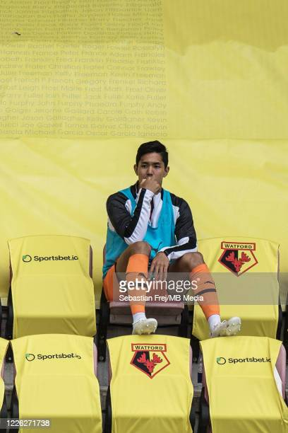 Yoshinori Muto of Newcastle United sits in the stands during the Premier League match between Watford FC and Newcastle United at Vicarage Road on...