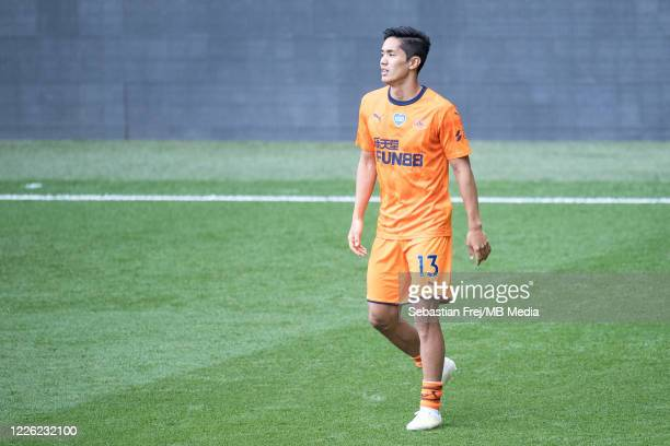Yoshinori Muto of Newcastle United warms up during the Premier League match between Watford FC and Newcastle United at Vicarage Road on July 11 2020...