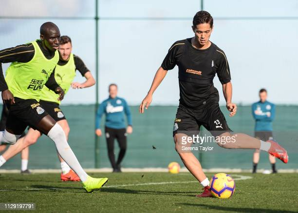 Yoshinori Muto passes the ball as Mohamed Diame looks to close him down during the Newcastle United warm weather training session at La Finca Golf...