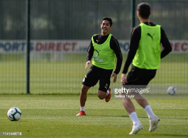 Yoshinori Muto passes the ball during the Newcastle United Training Session at the Newcastle United Training Centre on April 09 2019 in Newcastle...