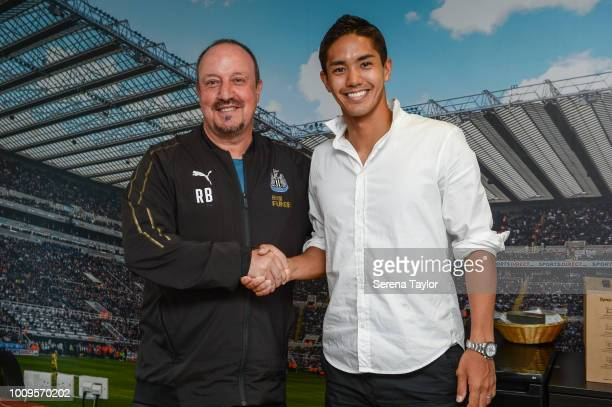 Yoshinori Muto poses for a photo with Newcastle United Manager Rafael Benitez during a photocall at the Newcastle United Training Centre on July 27...