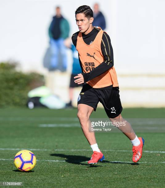 Yoshinori Muto runs with the ball during the Newcastle United Warm Weather Training Camp at La Finca Golf Resort on February 13 2019 in Callosa de...