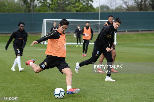 Yoshinori Muto strikes the ball during the Newcastle United Training Session at the Newcastle United Training Centre on April 24 2019 in Newcastle...