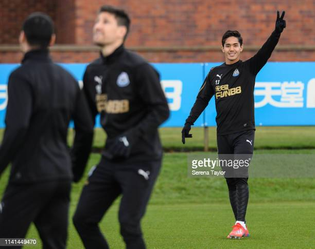 Yoshinori Muto waves to the camera during the Newcastle United Training Session at the Newcastle United Training Centre on April 09 2019 in Newcastle...