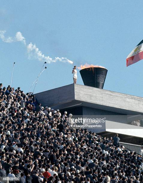 Yoshinori Sakai lights the Olympic flame during the Opening Ceremony of the Summer Olympic Games in Tokyo on 10th October 1964