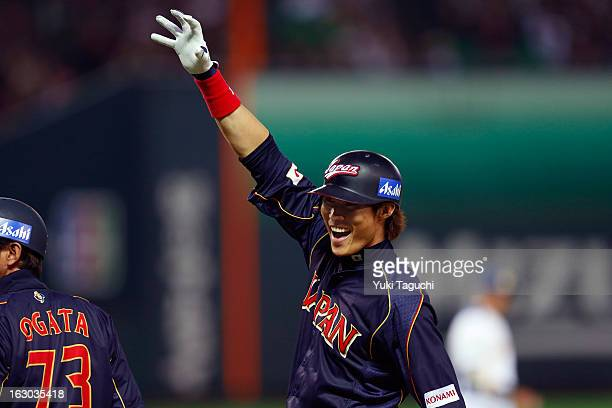 Yoshio Itoi of Team Japan reacts to hitting a RBI single in the top of the third inning during Pool A Game 1 between Team Japan and Team Brazil...