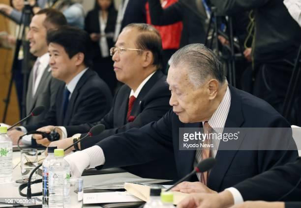 Yoshiro Mori chief of the organizing committee for the Tokyo Olympics and Paralympics and Toshiro Muto committee director general attend an...