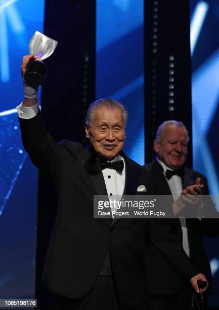 Yoshiro Mori of Japan receives the Vernon Pugh Award for Distinguished Service from Bill Beaumont World Rugby via Getty Images Chairman during the...