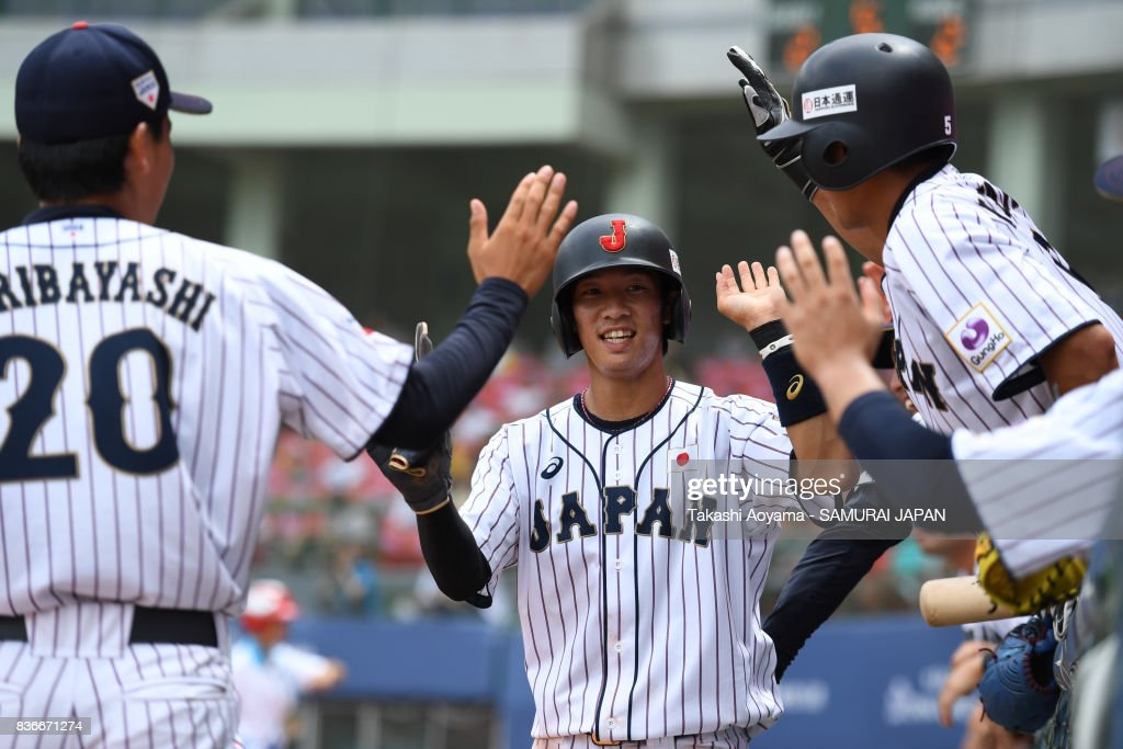Yoshitaka Nagasawa #24 of Japan cerebrates a score with his teammates during the Baseball Group B match between Japan and Mexico during the Universiade Taipei at the Xinzhuang Baseball Stadium on August 22, 2017 in Taipei, Taiwan.
