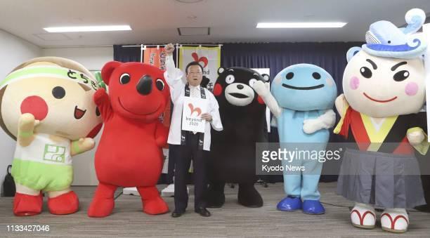 Yoshitaka Sakurada Japanese minister in charge of the 2020 Tokyo Olympics and Paralympics poses with mascot characters from Tochigi Chiba Kumamoto...
