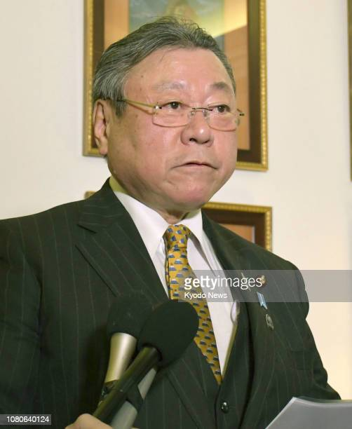 Yoshitaka Sakurada minister in charge of the 2020 Tokyo Olympics and Paralympics speaks at a press conference in Paris on Jan 10 2019 ==Kyodo