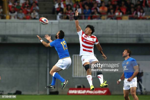 Yoshitaka Tokunaga of Japan and Jayden Hayward of Italy compete for the ball during the rugby international match between Japan and Italy at Noevir...