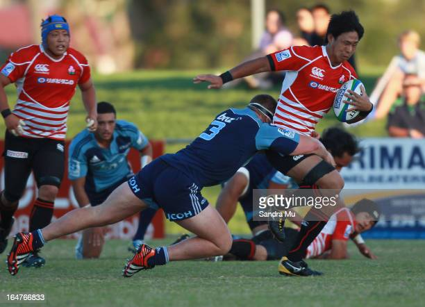 Yoshitaka Tokunaga of Japan is tackled during the Pacific Rugby Cup match between the Blues Development and Junior Japan at Bell Park on March 28...