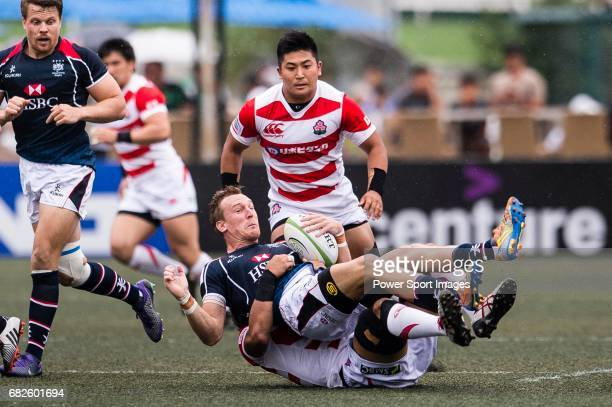 Yoshitaka Tokunaga of Japan puts a tackle on Alex McQueen of Hong Kong during the Asia Rugby Championship 2017 match between Hong Kong and Japan on...