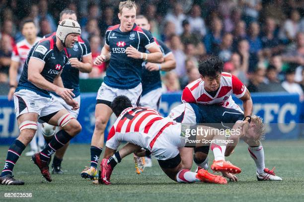 Yoshitaka Tokunaga of Japan puts a tackle on Jamie Hood of Hong Kong during the Asia Rugby Championship 2017 match between Hong Kong and Japan on May...