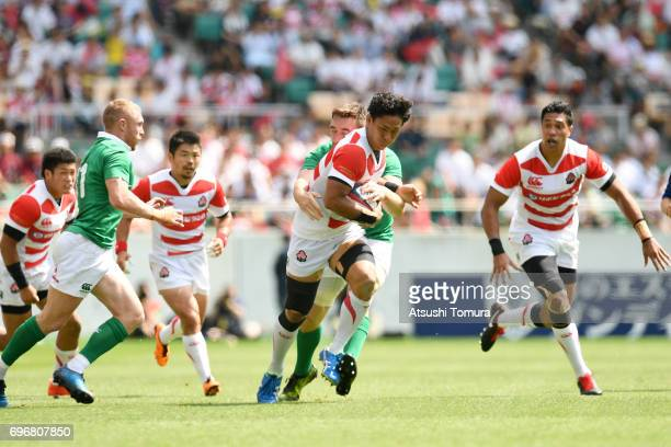 Yoshitaka Tokunaga of Japan runs with the ball during the international rugby friendly match between Japan and Ireland at Shizuoka Stadium on June 17...