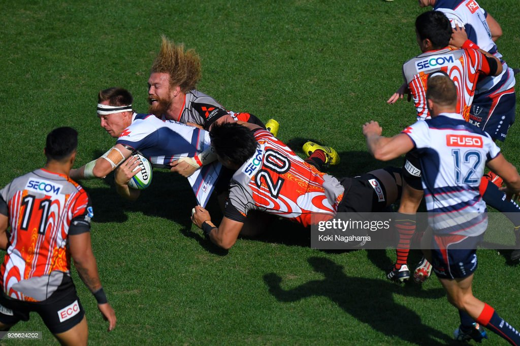 Yoshitaka Tokunaga #20 of Sunwolves and Willem Britz #5 of Sunwolves make a tackle on Jack Maddocks #14 of Rebels during the Super Rugby round 3 match between Sunwolves and Rebels at the Prince Chichibu Memorial Ground on March 3, 2018 in Tokyo, Japan.