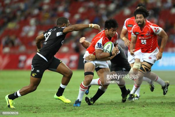 Yoshitaka Tokunaga of the Sunwolves attempts to go past Johan Deysel of the Sharks during the round 13 Super Rugby match between the Sunwolves and...