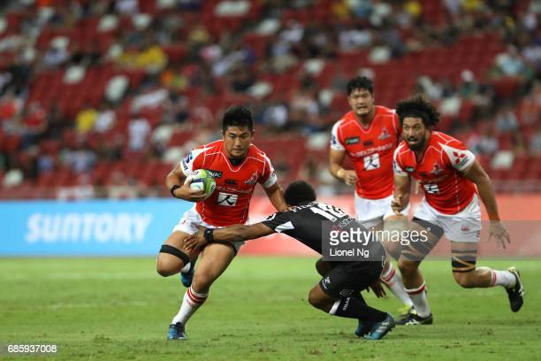 Yoshitaka Tokunaga of the Sunwolves is tackled by Garth April of the Sharks during the round 13 Super Rugby match between the Sunwolves and the...