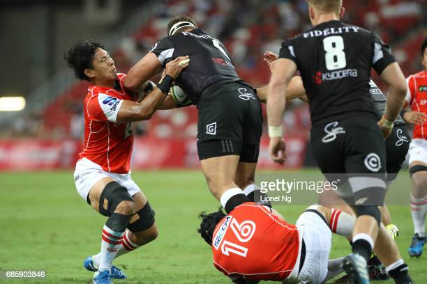 Yoshitaka Tokunaga of the Sunwolves tackles Thomas du Toit of the Sharks during the round 13 Super Rugby match between the Sunwolves and the Sharks...