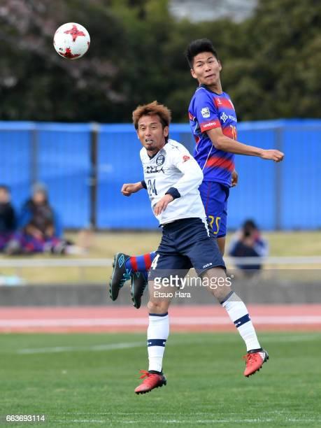 Yoshitake Suzuki of FC Tokyo U-23 and Toshihiro Matsushita of Kagoshima United compete for the ball during the J.League J3 match between FC Tokyo...