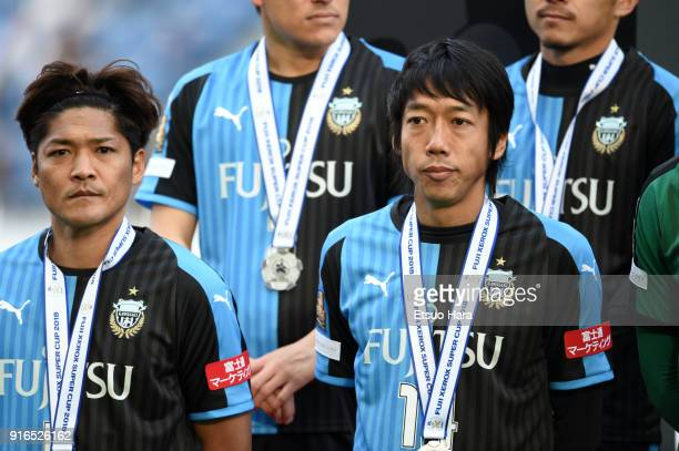Yoshito Okubo and Kengo Nakamura of Kawasaki Frontale are seen during the medal ceremony after the Xerox Super Cup match between Kawasaki Frontale...