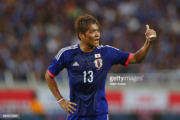 Yoshito Okubo gestures to a team mate during the Kirin Challenge Cup international friendly match between Japan and Cyprus at Saitama Stadium on May...