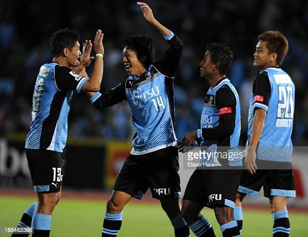 Yoshito Okubo Kengo Nakamura Renato Ribeiro Calixto and Junichi Inamoto of Kawasaki Frontale celebrate the win after the JLeague match between...