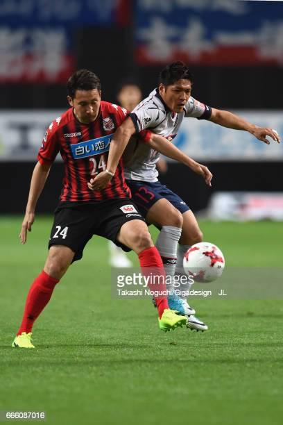 Yoshito Okubo of FC Tokyo and Akito Fukumori of Consadole Sapporo compete for the ball during the JLeague J1 match between Consadole Sapporo and FC...