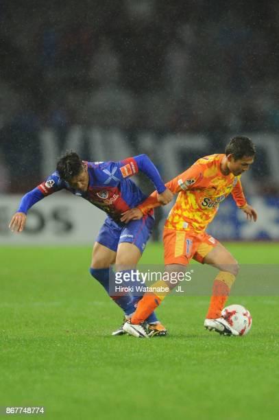 Yoshito Okubo of FC Tokyo and Yosuke Kawai of Shimizu SPulse compete for the ball during the JLeague J1 match between FC Tokyo and Shimizu SPulse at...