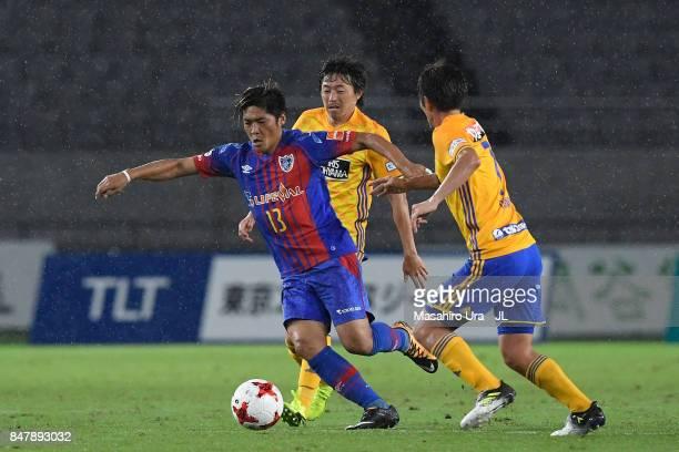 Yoshito Okubo of FC Tokyo competes for the ball against Naoki Ishihara and Hiroaki Okuno of Vegalta Sendai during the JLeague J1 match between FC...