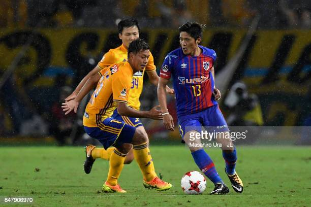 Yoshito Okubo of FC Tokyo controls the ball under pressure of Gakuto Notsuda of Vegalta Sendai during the JLeague J1 match between FC Tokyo and...
