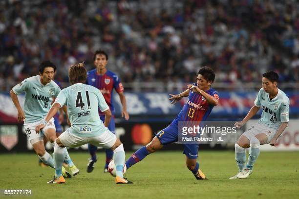 Yoshito Okubo of FC Tokyo controls the ball under pressure of Jubilo Iwata defense during the JLeague J1 match between FC Tokyo and Jubilo Iwata at...