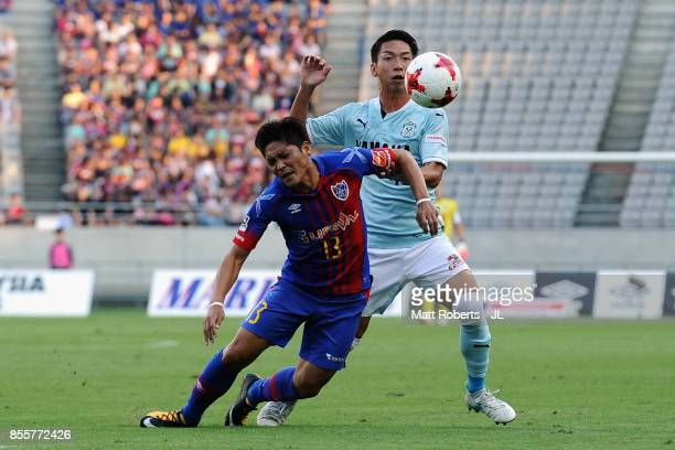Yoshito Okubo of FC Tokyo is challenged by Hayao Kawabe of Jubilo Iwata during the JLeague J1 match between FC Tokyo and Jubilo Iwata at Ajinomoto...