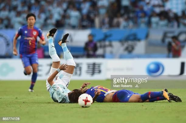 Yoshito Okubo of FC Tokyo is fouled by Shohei Takahashi of Jubilo Iwata during the JLeague J1 match between FC Tokyo and Jubilo Iwata at Ajinomoto...