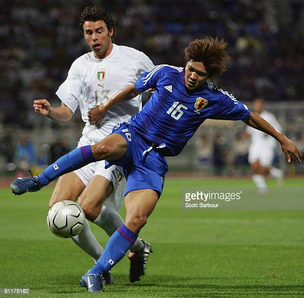 Yoshito Okubo of Japan and Andrea Barzagli of Italy compete for the ball in the Italy v Japan men's football preliminary match on August 15, 2004...