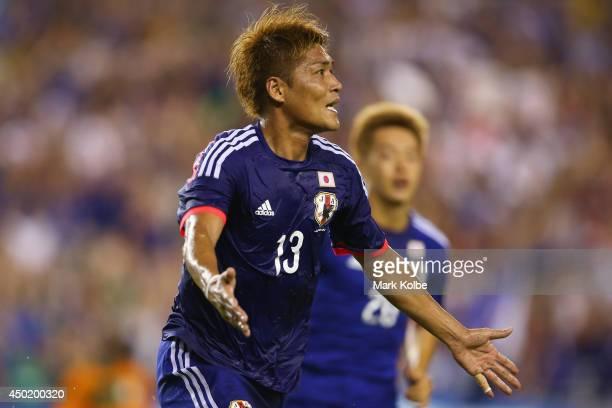 Yoshito Okubo of Japan celebrates scoring a goal during the International Friendly Match between Japan and Zambia at Raymond James Stadium on June 6,...
