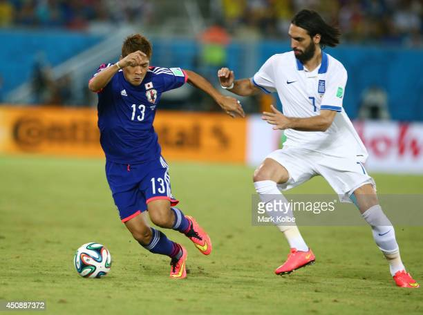 Yoshito Okubo of Japan controls the ball against Giorgos Samaras of Greece during the 2014 FIFA World Cup Brazil Group C match between Japan and...