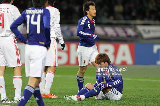 Yoshito Okubo of Japan ireacts after missing a chance during the East Asian Football Championship match between Japan and China at the National...