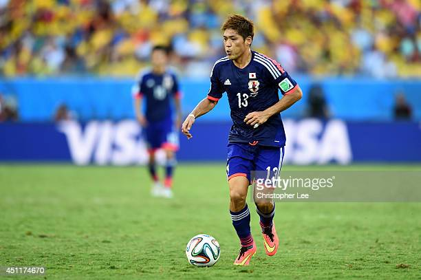 Yoshito Okubo of Japan on the ball during the 2014 FIFA World Cup Brazil Group C match between Japan and Colombia at Arena Pantanal on June 24, 2014...